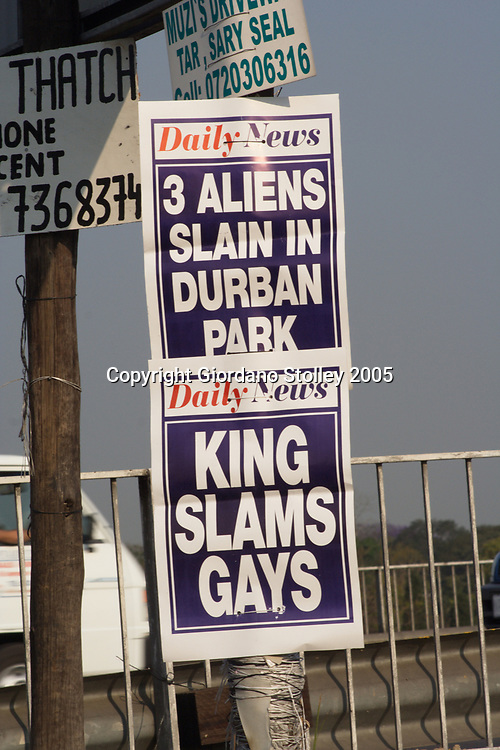 """DURBAN - 12 September 2005 - Posters from Durban's afternoon daily newspaper, The Daily News are displayed on a street pole in the city. The posters highlight two controversial subjects in South Africa on any given day - illegal immigration and homossexuality, which Zulu King Goodwill Zweilithini had labeled as being """"un-African"""". Picture: Giordano Stolley"""