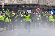 Mcc0086782 . Daily Telegraph<br /> <br /> DT News<br /> <br /> A protestor jumps to avoid the jet from a water canon <br /> <br /> Scenes on the on Ave de Freidland and Blvd Hausmann as protests turn violent in Paris for another weekend .<br /> <br /> Paris 8 December  2018