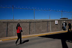 People walk around a Mexican customs and immigration office at the border. This is the point where Mexicans arrive after being deported by the US.