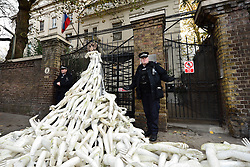 A police officer gestures outside the Russian embassy in London where 25 activists from two campaign groups The Syria Campaign and Syria Solidarity UK scattered over 800 limbs around the gates of the building in a protest at the bombing of civilians in east Aleppo.