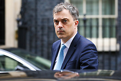 "© Licensed to London News Pictures. 20/03/2019. London, UK. Julian Smith - Parliamentary Secretary to the Treasury (Chief Whip) departs from No 10 Downing Street. According to No 10 Downing Street, later today British Prime Minister Theresa May will write to European Union chiefs requesting a ""short"" delay to the date Britain leaves the EU. Photo credit: Dinendra Haria/LNP"