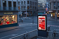curfew from 9 pm during corona pandemic lockdown on May 5th. 2021. Display near dome prompts to get tested for Covid, Cologne, Germany.<br /> <br /> Ausgangssperre ab 21 Uhr waehrend des Corona Lockdowns am 5. Mai 2021. Display nahe Dom fordert auf sich auf Covid testen zu lassen, Koeln, Deutschland.