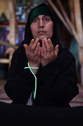 June 5, 2017 - Srinagar, Jammu and Kashmir, India - A woman prays at a Sufi Shrine in Srinagar, Indian Controlled Kashmir during the month of Ramadan. (Credit Image: © Muzamil Mattoo/Pacific Press via ZUMA Wire)
