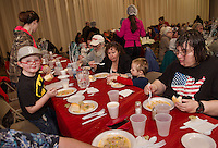 Jayden Grady, Norman and Deborah Judkins, Gavin Gasper and Linda Shea have dinner together with Hands Across the Table at St Andre Bassette Parish Hall on Wednesday evening.  (Karen Bobotas/for the Laconia Daily Sun)