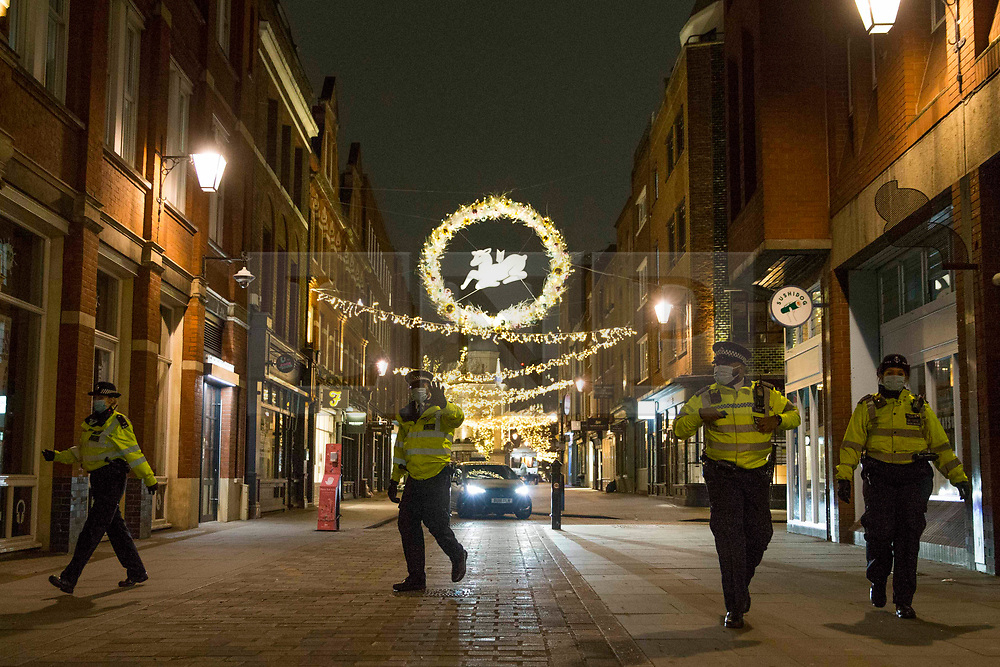 © Licensed to London News Pictures.31/12/2020, London, UK. Police paroling the streets in central London as three quarters of England plunged into Tier 4 last night. This New Year's Eve Londoners need to stay at home according to Tier 4 guidelines. Photo credit: Marcin Nowak/LNP