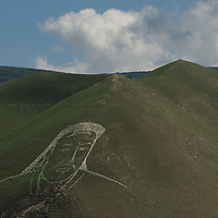 Rockwork depicting Chinghis Khan adorns a hill above Ulaanbaatar, Mongolia.