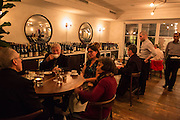 New York, NY, - December 8, 2013. Diners in the Barrel Room of The Musket Room, a dining room at the back of the house, overlooking a garden. The Musket Room is at 265 Elizabeth St.