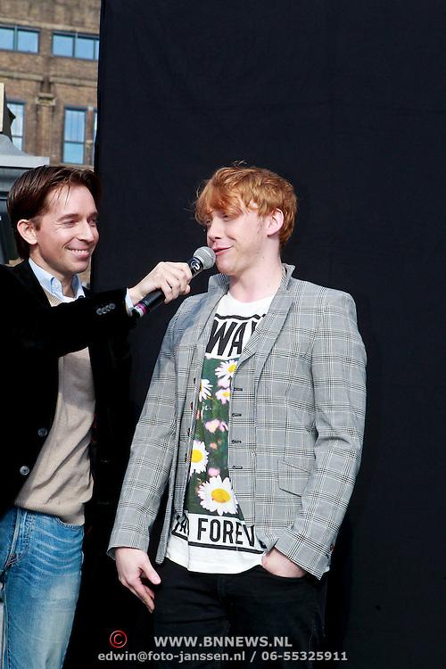 NLD/Amsterdam/20110630 - Opening fototenstoonsteling Harry Potter door acteurs Rupert Grint, James en Oliver Phelps,