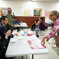 Daisy Burnside picks up her Nez Lizer campaign sign after getting signatures from Jonathan Nez and his wife Phefelia Herbert-Nez, Sunday Sept. 30, 2018 at a meet and greet with the candidates at the Chichiltah chapter house.