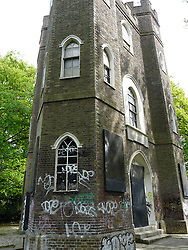 © Licensed to London News Pictures. 18/07/2014. Archive photo of graffiti at Severndroog before restoration. Supplied by Severndroog Castle Building Preservation Trust. An 18th century castle on a hill in south east London is preparing to reopen this weekend following a lengthy, painstaking restoration project. Severndroog Castle in Oxleas Woods on Shooters Hill enjoys stunning views across seven counties on a clear day. The folly has been closed for many years and was in state of disrepair before work started on a restoration project last year. The historic building featured in the BBC series Restoration in 2004. The reopening takes place on Sunday July 20th - more information about the castle and the reopening available fron the Severndroog Castle Building Presevation Trust. http://www.severndroogcastle.org.uk/index.html Credit : Rob Powell/LNP