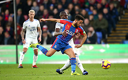 Crystal Palace's Andros Townsend and Cardiff City's Sol Bamba battle for the ball during the Premier League match at Selhurst Park, London.