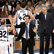 Anadolu Efes's coach Ufuk SARICA (C) during their Turkish Basketball League match Anadolu Efes between Aliaga Petkim at Aliaga Arena in Istanbul, Turkey, Sunday, October 23, 2011. Photo by TURKPIX