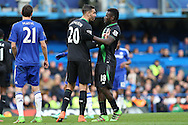 Geoff Cameron of Stoke City pushes his teammate  Mame Biram Diouf of Stoke City. Barclays Premier league match, Chelsea v Stoke city at Stamford Bridge in London on Saturday 5th March 2016.<br /> pic by John Patrick Fletcher, Andrew Orchard sports photography.