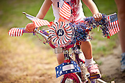 A bicycle decorated in patriotic themes during the I'On Community 4th of July parade.