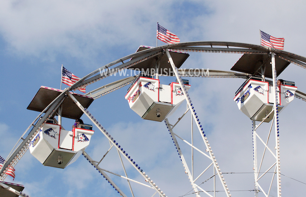 New Paltz, NY - People ride on the ferris wheel at the Ulster County Fair on Aug. 3, 2008.