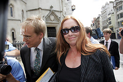"""Deborah Tait, sister of murdered Hollywood actress Sharon, arrives at the Royal Courts of Justice. She is giving evidence as film director Roman Polanski is suing Conde Naste, publishers of Vanity Fair, over a July 2002 article about the events of August 1969 when 26-year-old Sharon Tate, who was eight months pregnant, and four friends were slaughtered at her Californian home by Charles Manson's """"Family""""."""