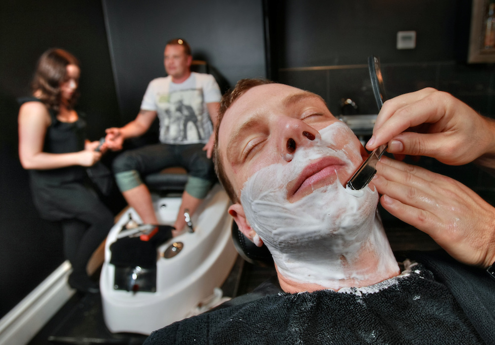 Contact Rob Gauci of Manhor - ''mens' grooming lounge'' shaves groom David Arkeveld while his brother & best man Benedict Arkeveld is treated to a manicure & pedicure at the hands of Gemma Zammit. Pic By Craig Sillitoe CSZ / The Sunday Age.16/06/2012  Pic By Craig Sillitoe CSZ / The Sunday Age melbourne photographers, commercial photographers, industrial photographers, corporate photographer, architectural photographers, This photograph can be used for non commercial uses with attribution. Credit: Craig Sillitoe Photography / http://www.csillitoe.com<br /> <br /> It is protected under the Creative Commons Attribution-NonCommercial-ShareAlike 4.0 International License. To view a copy of this license, visit http://creativecommons.org/licenses/by-nc-sa/4.0/.