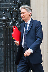London, February 10th 2015. Ministers arrive at the weekly cabinet meeting at 10 Downing Street. PICTURED: Foreign Secretary Philip Hammond.