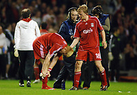 Dirk Kuyt (Liv) consoles John Arne Riise after putting the ball into his own net for Chelsea's equaliser in injury time. Liverpool v Chelsea 22/4/2008 Champions League Semi Final 1st leg Anfield Credit : Colorsport / Andrew Cowie