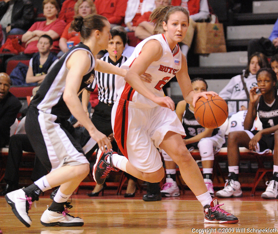 Feb 21, 2009; Piscataway, NJ, USA; Rutgers forward Heather Zurich (21) drives to the net against Providence guard Chelsea Marandola (10) during the first half of Rutgers' 55-42 victory over Providence at the Louis Brown Athletic Center.