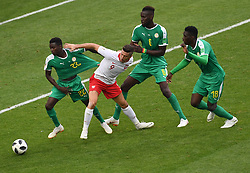 MOSCOW, June 19, 2018  Robert Lewandowski (2nd L) of Poland vies with Moussa Wague (1st L) of Senegal during a Group H match between Poland and Senegal at the 2018 FIFA World Cup in Moscow, Russia, June 19, 2018. Senegal won 2-1. (Credit Image: © Wang Yuguo/Xinhua via ZUMA Wire)