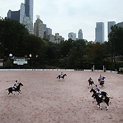 Action during the Central Park Arena Polo Challenge held in the Wollman Ice Rink in Central Park showing a City backdrop. The event was the first ever polo match played at Central Park and was part of the four day Central Park Horse Show. Central Park, Manhattan, New York, USA. 21st September 2014. Photo Tim Clayton