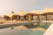 Swimming pool and camp at Haonib Safari Camp, Skeleton Coast, North Namibia, Southern Africa