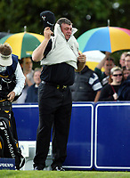 Photograph: Scott Heavey<br />Volvo PGA Championship At Wentworth Club. 25/05/2003.<br />Darren Clarke covers up from the rain.