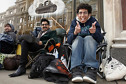 © Licensed to London News Pictures.  14/03/2012. LONDON, UK. Fans queue outside the flagship Apple store in Regent Street London ahead of the Friday (16 March)  launch of the new iPad 3. First in the queue Zohaib Ali (pictured right), 21, a pharmacy worker from Uxbridge, started queuing at 1pm on Saturday, six days before the product goes on sale. In this photo right to left, Zonhaib Ali (21). Vik Rathor (25), Mike Roberts (22). Photo credit :  Cliff Hide/LNP