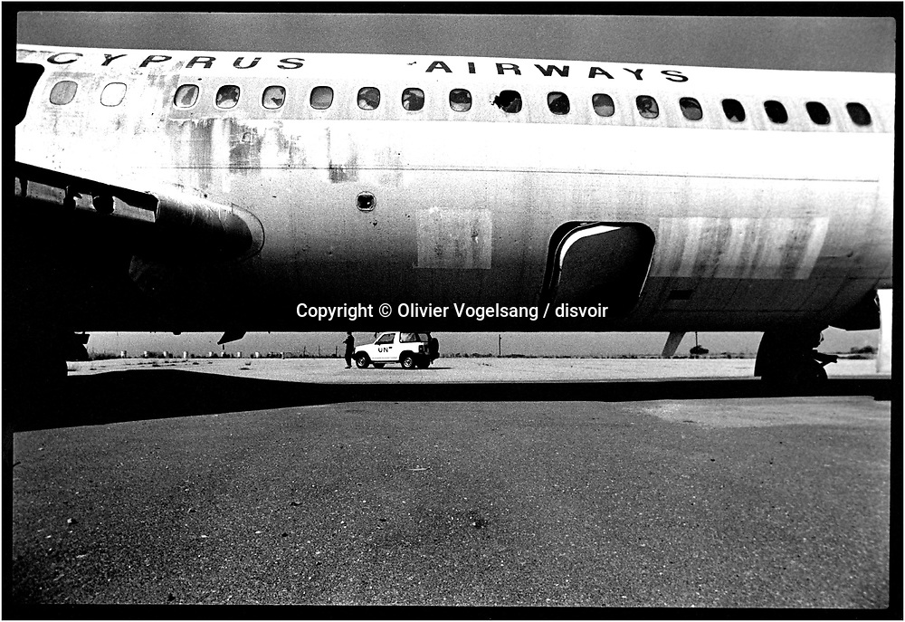 Cyprus. Nicosia. This plane of the Cyprian lines was on the track of the airport of Nicosia at the time of the turkish invasion. Since the demilitarization of the airport and its takeover by United Nations, it did not move. It thus has been 23 years that this device as well as tracks are in this state.