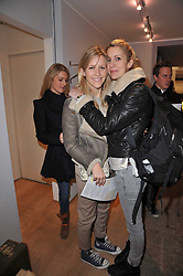 Left to right, CALANDRA CALDECOTT and LADY CANDIDA BALFOUR at the launch party for Club Monaco at Browns, 32 South Molton Street, London on 16th February 2011.
