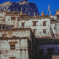 Old stone buildings rise up a hill in Jarkot Village, north of Annapurna in Nepal.