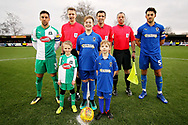 Mascots, captains and officials walking before the EFL Sky Bet League 1 match between AFC Wimbledon and Plymouth Argyle at the Cherry Red Records Stadium, Kingston, England on 26 December 2018.