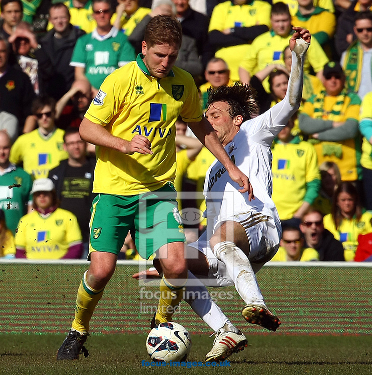 Picture by Paul Chesterton/Focus Images Ltd +44 7904 640267.06/04/2013.Michael Turner of Norwich and Michu of Swansea in action during the Barclays Premier League match at Carrow Road, Norwich.