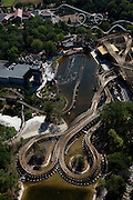 Nederland, Noord-Brabant, Gemeente Loon op Zand., 08-07-2010; Kaatsheuvel, .attractiepark de Efteling, overzicht attracties: Joris en de Draak - .nieuwe houten racer-achtbaan,  De Vliegende Hollander - waterachtbaan (met kasteel) en de Python - achtbaan (met diverse 'loops')..The theme park Efteling, overview  with he St George and the Dragon -.new wooden racer roller coaster, The Flying Dutchman water roller coaste (with castle) and  the Python (roller coaster with loops)..luchtfoto (toeslag), aerial photo (additional fee required).foto/photo Siebe Swart