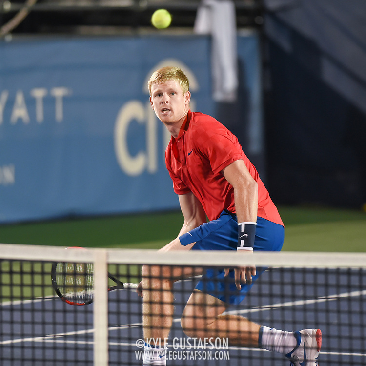 KYLE EDMUND hits a volley during his second round match at the Citi Open at the Rock Creek Park Tennis Center in Washington, D.C.