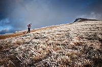 Hiker walks on Beacons Way towards Corn Du, Brecon Beacons national park, Wales