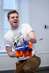 © Licensed to London News Pictures. 19/07/2012. LONDON, UK. A member of staff from toy producer Hasbro demonstrates the new 'Nerf N-Strike Elite Hail-Fire' launcher at the company's 'Christmas in July' toy launch in London today (19/07/12). The toy gun, which holds 144 mini Nerf darts in 8 magazines, is set to hit the shops for Christmas 2012 priced at GB£44.99. Photo credit: Matt Cetti-Roberts/LNP