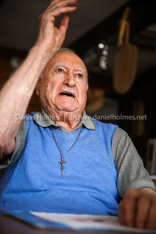 (4/2/14, MILFORD, MA) Veteran Joesph Manella, shot down in his B-24 and a Japanese POW for two years, tells some stories from the war at his home in Milford on Wednesday. Daily News and Wicked Local Photo/Dan Holmes