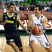 Efes Pilsen's Kerem TUNCERI (R) and Fenerbahce Ulker's Roko Leni UKIC (L) during their Turkish Basketball league Play Off Final first leg match Efes Pilsen between Fenerbahce Ulker at the Ayhan Sahenk Arena in Istanbul Turkey on Thursday 20 May 2010. Photo by Aykut AKICI/TURKPIX