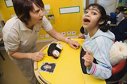 Girl with cerebral palsy using alternative communication,