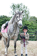 09/08/2012 Repro free first use. Five year old Launa McCann with her horse Curley from Hollywood, Co.Wicklow  at the Connemara Pony Show in Clifden County Galway . Photo:Andrew Downes.
