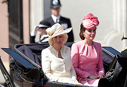 The Duchess of Cornwall and The Duchess of Cambridge make their way down The Mall from Buckingham Palace, central London to Horse Guards Parade for the Trooping the Colour ceremony as the Queen celebrates her official birthday today.