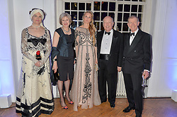 Left to right, LADY FELLOWES, the Home Secretary THERESA MAY, LADY JUBIE WIGAN, PHILIP MAY and LORD FELLOWES at the Sugarplum Dinner in aid Sugarplum Children a charity supporting children with type 1 diabetes and raising funds for JDRF, the world's leading type 1 diabetes research charity held at One Marylebone, London on 18th November 2015.