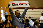 BIRMINGHAM, AL –SEPTEMBER 16, 2012: Jose Mangandi, one of several undocumented Latinos traveling across the country on the Undocubus, protests during a briefing on the civil rights effects of state immigration law held by the U.S. Commission on Civil Rights in Birmingham, Alabama on August 17, 2012.