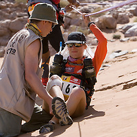 26 March 2007:  Injured Geraldine Courdesses of France, 2006 winner of the women race, needs for medical assistance near the summit of jebel El Otfal, 947 meters and an average 25% slope, during the second stage (21.7 miles) of the 22nd Marathon des Sables between Khermou and jebel El Otfal. The Marathon des Sables is a 6 days and 151 miles endurance race with food self sufficiency across the Sahara Desert in Morocco. Each participant must carry his, or her, own backpack containing food, sleeping gear and other material.