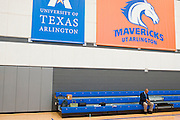 Dallas Wings head coach Fred Williams sits on the bleachers in a practice gym during the team media day in Arlington, Texas on May 5, 2016.  (Cooper Neill for The New York Times)