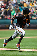 San Francisco Giants right fielder Gregor Blanco (1) runs to first base against the Oakland Athletics pitch at Oakland Coliseum in Oakland, California, on March 25, 2018. (Stan Olszewski/Special to S.F. Examiner)