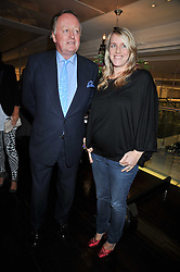 ANDREW PARKER BOWLES and his daughter LAURA LOPES at the launch of Tom Parker Bowles's new book 'Full English' held in the Gallery Restaurant, Selfridges, Oxford Street, London on 9th September 2009.