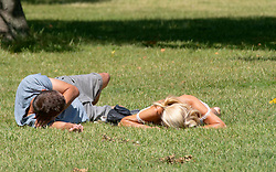 ©Licensed to London News Pictures 22/06/2020<br /> Greenwich, UK. A couple sunbathing. A warm sunny day in Greenwich park, Greenwich, London. The UK to enjoy hot heatwave weather this week with temperatures set to bring the hottest day of the year so far. Photo credit: Grant Falvey/LNP